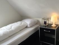 Slaapkamer met 2x 1 persoons bed