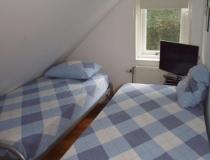 Kleine slaapkamer met 2x 1 pers. bed